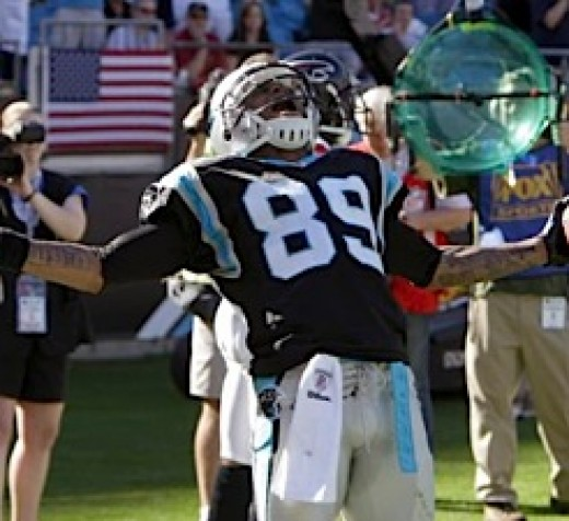 Carolina Panthers' Steve Smith (89) reacts after a touchdown catch against the Atlanta Falcons in the first half of an NFL football game in Charlotte, N.C., Sunday, Nov. 15, 2009. (AP Photo/Chuck Burton)