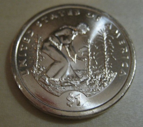 The reverse side of the Sacagawea $1 issued for Native American New Year 2009 with the National Museum of the American Indian. (pubic domain)
