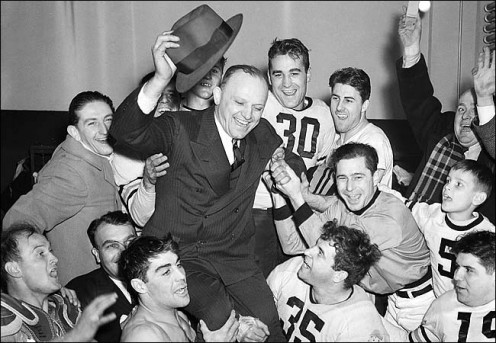 Chicago Bears players hoisted Coach George Halas on their shoulders after winning the 1940 N.F.L. title. A young Bill Anderson is at right.