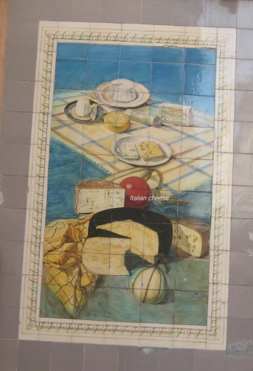 photo, a cheese shop with a tiled advert of the fabulous selection of Italian cheeses.