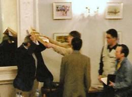Kasparov attempts to shield himself.