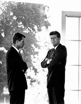 John Kennedy and His Brother Robert. John Kennedy is facing you and Bobby his brother , confident and closest political ally is facing sideways towards his brother.