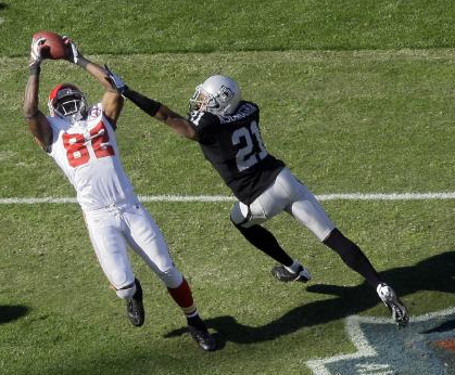 Kansas City Chiefs wide receiver Dwayne Bowe (82) reaches unsuccessfully for a pass as Oakland Raiders cornerback Nnamdi Asomugha (21) defends in the first quarter during an NFL football game in Oakland, Calif., Sunday, Nov. 15, 2009. (AP Photo/Jeff