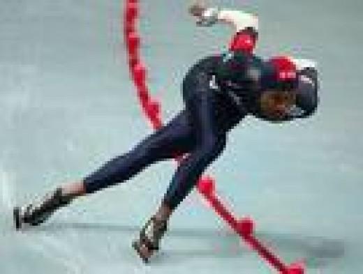 Shani Davis in full stride.  Zimbio.com's photo