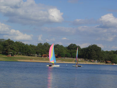 Hire boats or relax on the beach at Videix lake