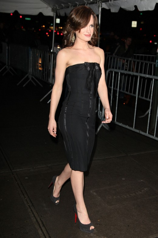 Elizabeth Reaser in a black strapless dress and suede open toe high heel pumps attending a New Moon premiere