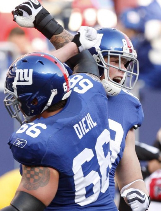 New York Giants offensive tackle David Diehl (66) celebrates with tight end Kevin Boss (89) after Boss scored a touchdown in the second quarter of an NFL football game against the Atlanta Falcons, Sunday, Nov. 22, 2009, in East Rutherford, N.J. (AP P
