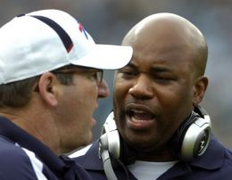 Buffalo Bills interim head coach Perry Fewell, right, talks with an assistant coach during the first quarter of an NFL football game against the Jacksonville Jaguars, Sunday, Nov. 22, 2009, in Jacksonville, Fla. (AP Photo/Stephen Morton)