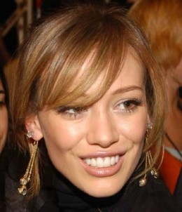 My, what large teeth you have! . . . Hilary Duff can barely contain her smile - literally