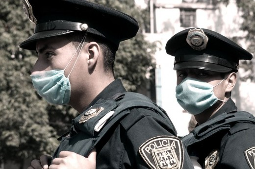 Mexican police wearing flu masks