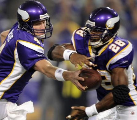 Minnesota Vikings quarterback Brett Favre (4) hands the ball off to running back Adrian Peterson (28) during the first quarter of a NFL football game on Sunday, Nov. 22, 2009, against Seattle Seahawks at the Metrodome in Minneapolis. (AP Photo/Hannah