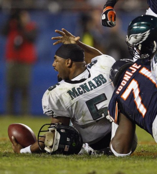 Philadelphia Eagles quarterback Donovan McNabb (5) reacts after losing his helmet and getting sacked by Chicago Bears defensive tackle Israel Idonije (71) in the second quarter of an NFL football game in Chicago, Sunday, Nov. 22, 2009. (AP Photo/Nam