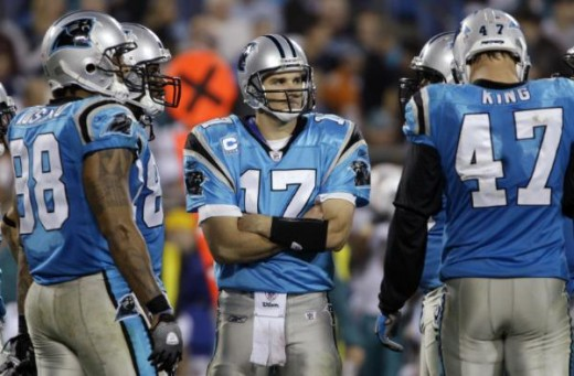 Jake Delhomme (17) waits near the huddle in the second half of the Panthers' 24-17 loss to the Miami Dolphins in an NFL football game in Charlotte, N.C., Thursday, Nov. 19, 2009. (AP Photo/Nell Redmond)