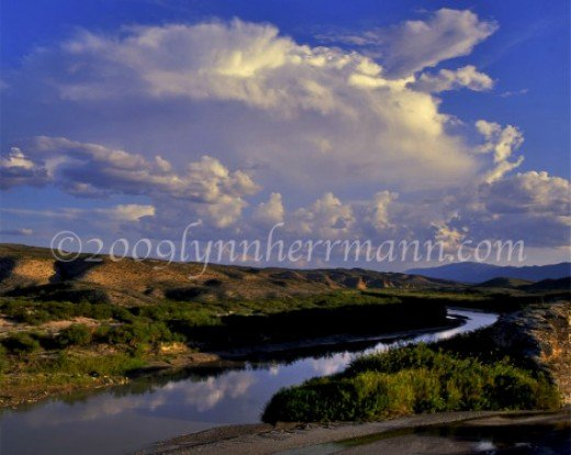 Clouds dance over Mexico as the Rio Grande river winds it way through the Big Bend.
