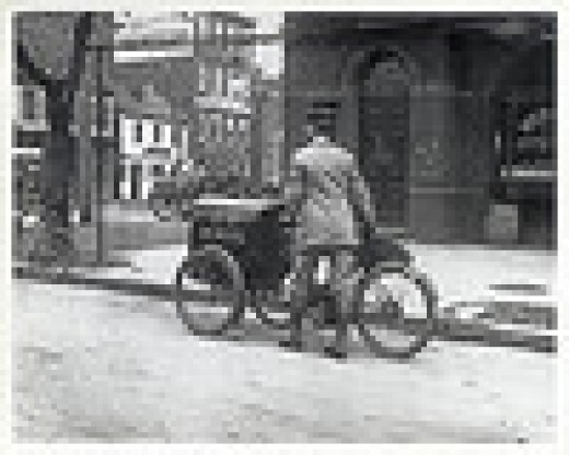 Three wheeled motorcycle - a far cry from today's fuel guzzling monsters.