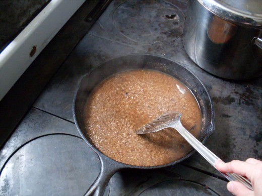 Add salt and cinnamon. Stir thoroughly, then cover tightly with a lid, and reduce heat to a slow simmer.