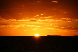 Beautiful sunset off the stern of a yacht in New Caledonia