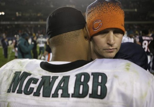 Jay Cutler and Donovan McNabb embrace at the end of the game. AP Photo/Charles Rex Arbogast