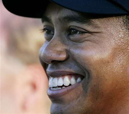AP - In this Aug. 20, 2006, file photo, Tiger Woods smiles after winning the PGA Championship golf tournament at Medinah Country Club in Medinah, Ill.