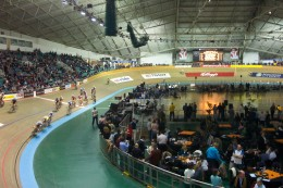 This is the Manchester Velodrome in the UK during a big international meeting. Track racing is a very specialized aspect of cycling; the bikes don't have a freewheel or brakes, so you must keep turning your pedals while moving!