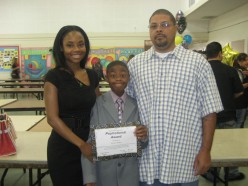 Mom, Brandon, Dad and an award