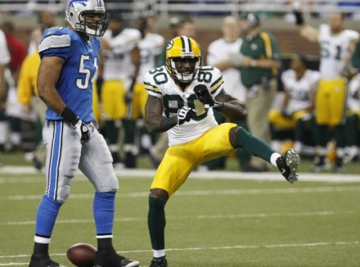 Green Bay Packers wide receiver Donald Driver (80) celebrates a catch in front of Detroit Lions linebacker DeAndre Levy (54) during the third quarter of an NFL football game in Detroit, Thursday, Nov. 26, 2009. (AP Photo/Carlos Osorio)