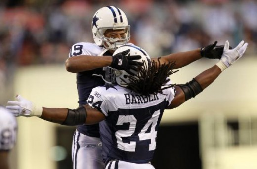 Miles Austin (19) celebrates his touchdown with running back Marion Barber (24) in the first half of an NFL football game against the Oakland Raiders,, Thursday, Nov. 26, 2009, in Arlington, Texas. (AP Photo/Erich Schlegel)