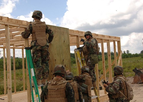 "US Navy Seabees, Naval Mobile Construction Battalion (NMCB) 133 build a ""Southwest Asia hut"" at Camp Shelby during field training."