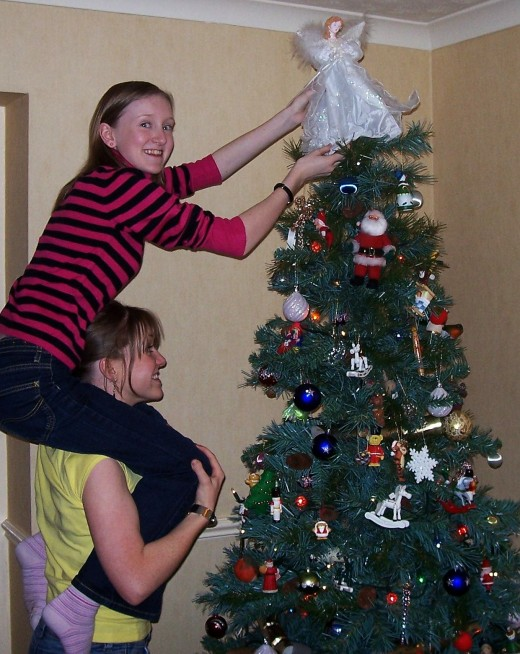 Putting the Angel on the top of the Christmas Tree