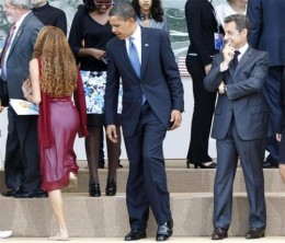 Notice how the President is admiring this 16 year old girls shoes...