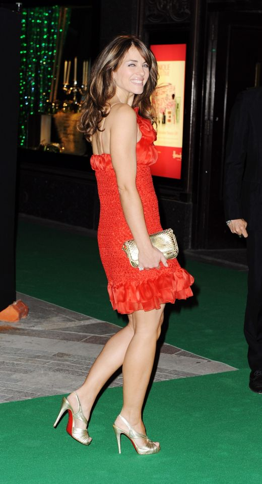 Elizabeth Hurley in a red dress and Christian Louboutin high heels