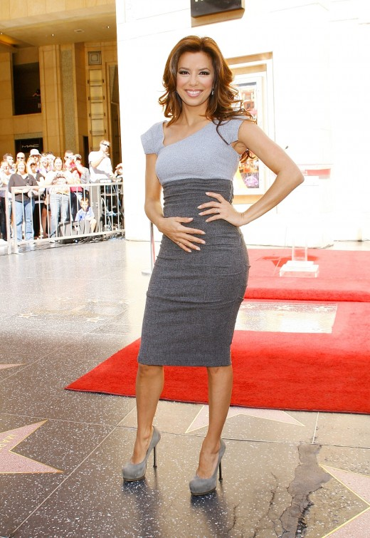Eva Longoria at l-oreal celebration of its 100th anniversary with a star on Hollywood walk of fame wearing a tight dress and high heels