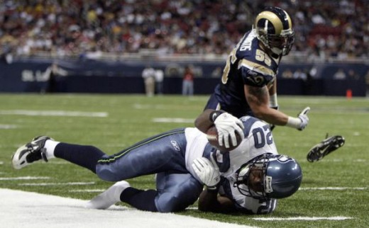 Seattle #20 Justin Forsett  is pushed out of bounds by St. Louis Rams linebacker James Laurinaitis, after running for a 4-yard gain.