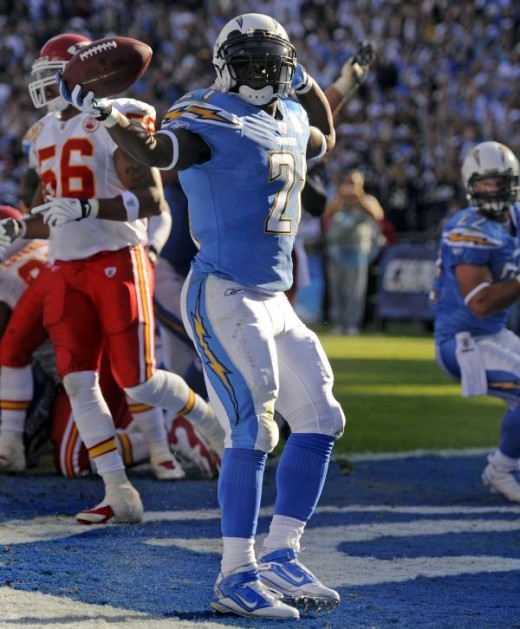 San Diego Chargers running back LaDainian Tomlinson, foreground, celebrates his one-yard touchdown run during the second quarter of n NFL football game against the Kansas City Chiefs on Sunday, Nov. 29, 2009, in San Diego. (AP Photo/Denis Poroy)