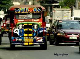 The Philippine jeepney beside a car