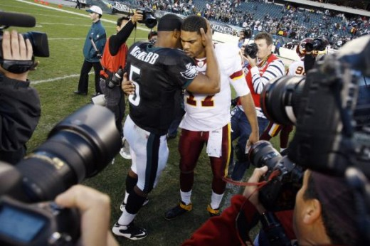 Donovan McNabb, center left, talks with Washington Redskins' Jason Campbell after an NFL football game, Sunday, Nov. 29, 2009, in Philadelphia. Philadelphia won 27-24. (AP Photo/Matt Slocum)