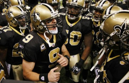 New Orleans Saints quarterback Drew Brees (9) rallies his teammates before their NFL football game against the New England Patriots, Monday, Nov. 30, 2009, in New Orleans. (AP Photo/Dave Martin)