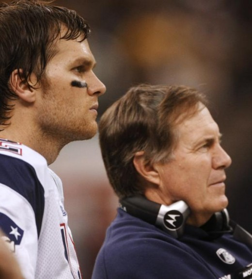 Tom Brady, left watches from the sidelines with head coach Bill Belichick during the fourth quarter of an NFL football game against the New Orleans Saints, Monday, Nov. 30, 2009, in New Orleans. (AP Photo/Dave Martin)