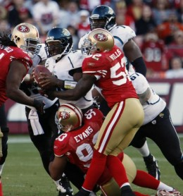 David Garrard, center, is brought down by San Francisco 49ers' Ray McDonald, top left, Demetric Evans, bottom, and Patrick Willis, top right, during the third quarter of an NFL football game in San Francisco, Sunday, Nov. 29, 2009. (AP Photo/Paul Sak