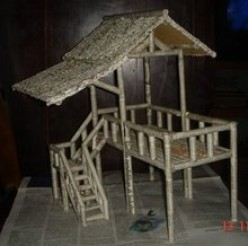 A traditional house miniature made of recycled newspaper (Image: ester-journey.blogspot.com)