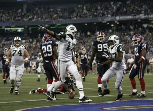 New York Jets wide receiver Braylon Edwards (17) reacts to his touchdown in the second quarter of an NFL football game against the Buffalo Bills in Toronto, on Thursday, Dec. 3, 2009. (AP Photo/Mike Groll)