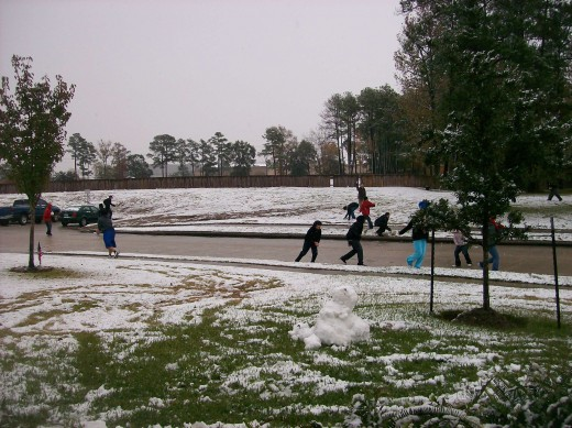 Our front yard and the school yard with students.