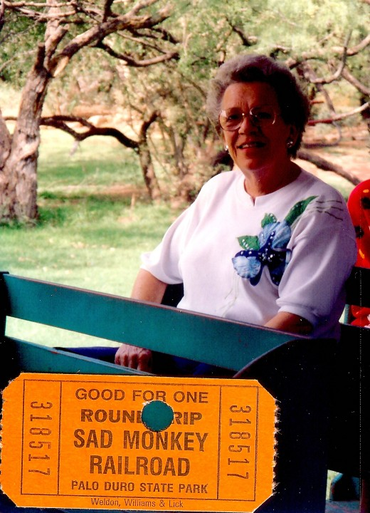 My mother on the Sad Monkey Railroad ride while touring Palo Duro Canyon