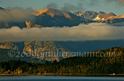 The north shore of Lago Nahual Huapi, in Argentina, is the location for photographing great early morning light on the mountains behind Bariloche.  If your base is Bariloche, scout out a morning session the day before.  Otherwise, numerous possibilii
