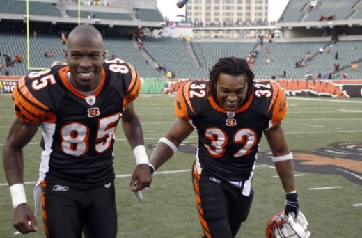 Chad Ochocinco, left, and teammate Cedric Benson run off the field after the Bengals posted a 23-13 win in their NFL football game against the Detroit Lions in Cincinnati, Sunday, Dec. 6, 2009. (AP Photo/David Kohl)