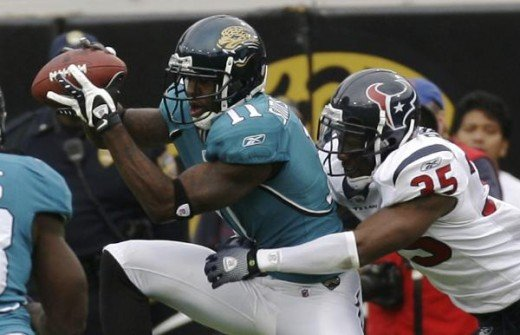 Mike Sims-Walker makes a third-quarter reception in front of Houston Texans cornerback Jacques Reeves during an NFL football game, Sunday, Dec. 6, 2009, in Jacksonville, Fla. (AP Photo/Phil Coale)
