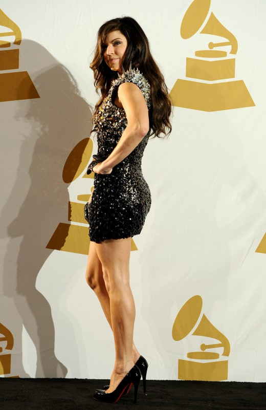 Fergi at the Grammy Nominations concert wearing a mini dress and Christian Louboutin high heel pumps