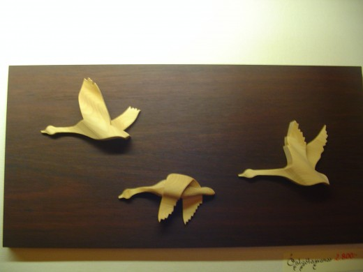 Flying Swans wooden hanging in Gamla Linkoping woodcraft shop
