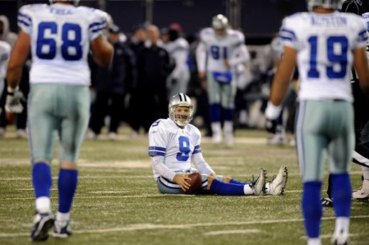 Tony Romo (9) sits on the field after getting sacked in the second quarter of an NFL football game against the New York Giants at Giants Stadium in East Rutherford, N.J., Sunday, Dec. 6, 2009. The Giants won the game 31-24. (AP Photo/Bill Kostroun)