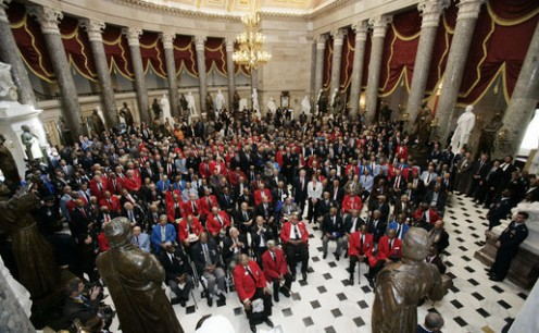 US President George W. Bush and Speaker of the House Nancy Pelosi stand with Tuskegee Airmen during Congressional Gold Medal Ceremony on March 29, 2007, in the US Capitol.